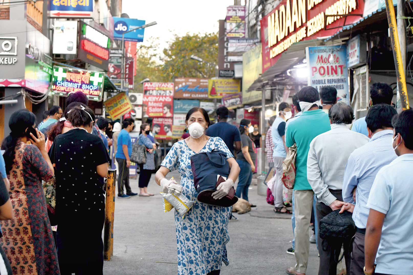 People comes out from their houses in Noida on Wednesday during the lockdown after the Uttar Pradesh government order to seal hotspots in 15 districts to control the spread of coronavirus.