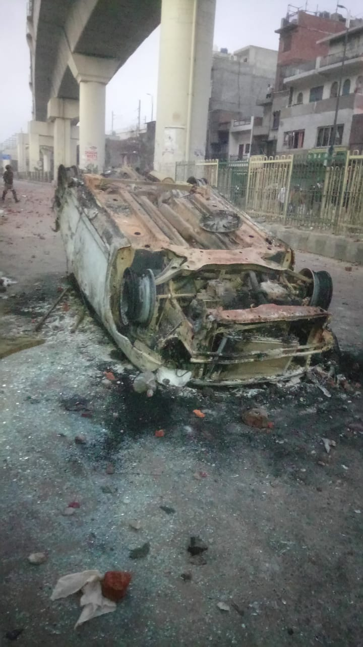 A burnt vehicle on he 500 metre stretch between Jaffrabad and Maujpur.