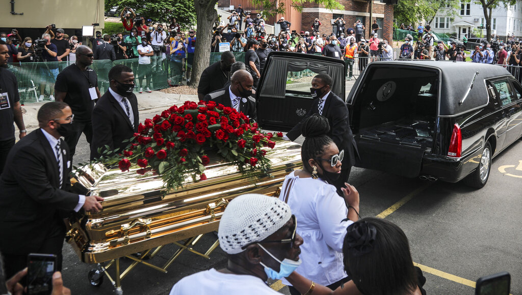 George Floyd's casket carried to a hearse after a memorial service for Floyd at North Central University on Thursday, June 4, in Minneapolisyoffffffffffffur knee off our necks', says Rev Al Sharpton