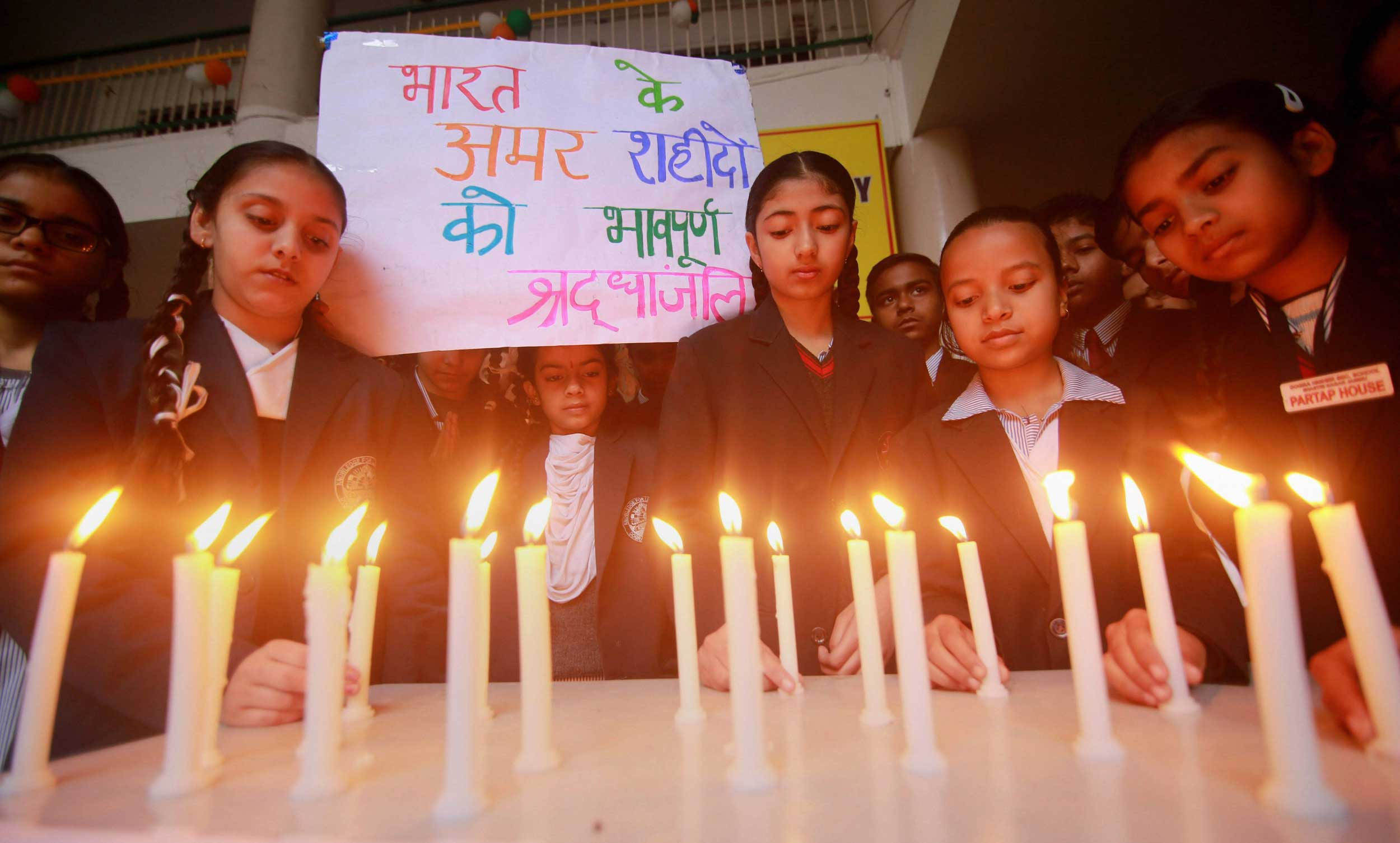 Students light candles to pay tribute to the soldiers killed in the Pulwama terror attack at a school in Jammu on Thursday.