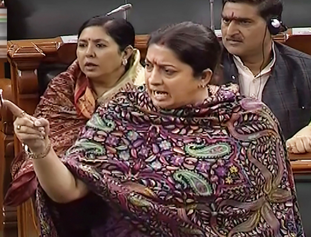 Woman and Child Welfare Minister Smriti Irani speaks in the Lok Sabha during the Winter Session of Parliament, in New Delhi, Friday, December 6, 2019.