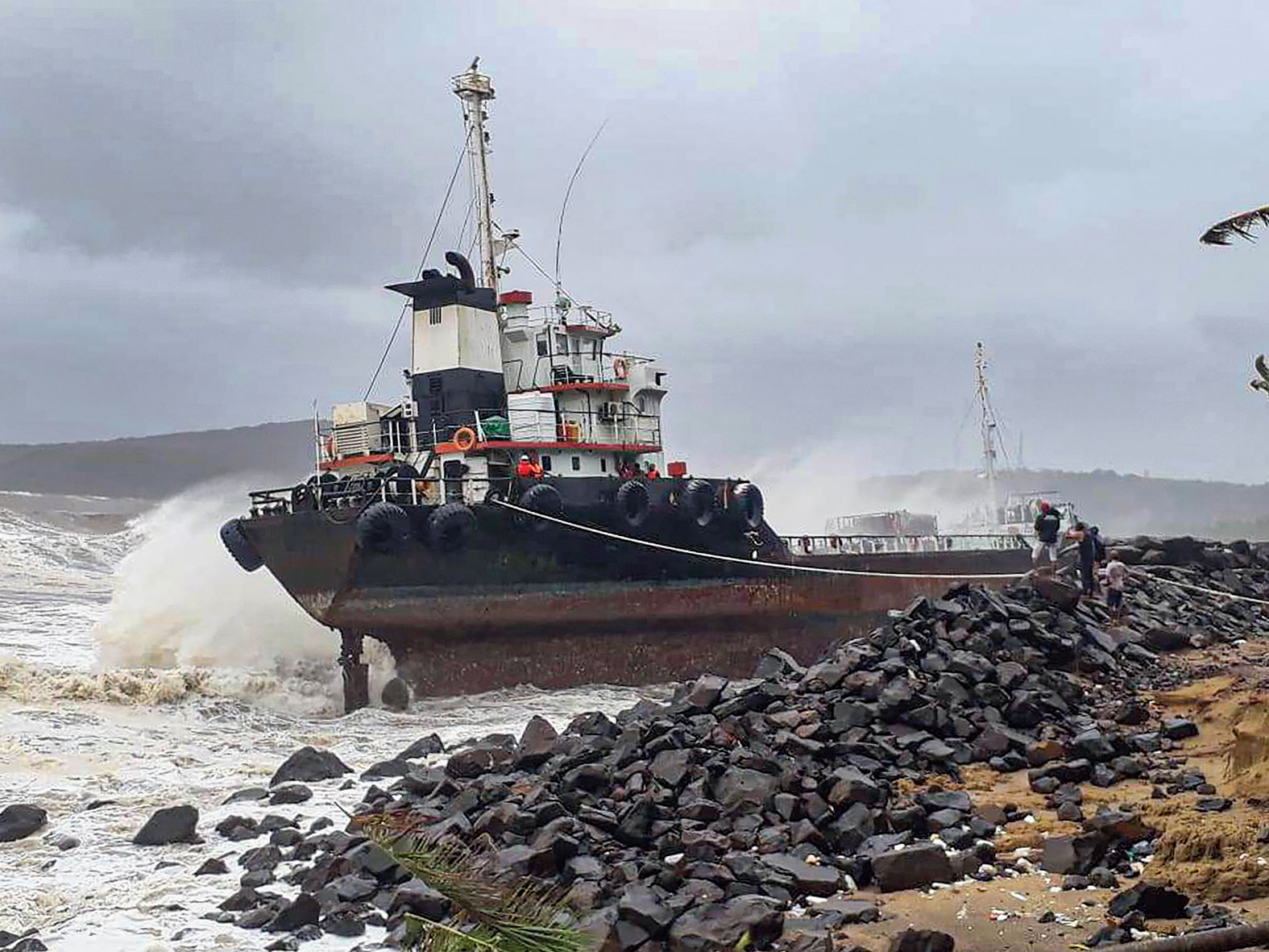 A wave strikes a vessel near Mirya embankment at Ratnagiri Narmada Cement Port.