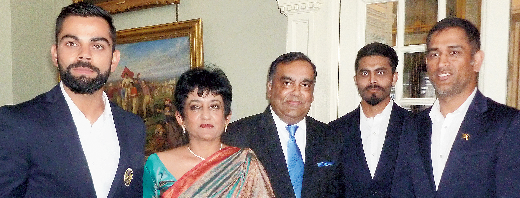 Yashvardhan Kumar Sinha (centre, with tie) and wife Girija Sinha in the Long Room at Lord's with Virat Kohli (left) and MS Dhoni (right) in June 2017