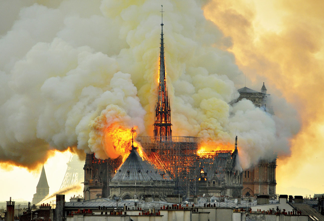 Flames and smoke rise from the Notre-Dame cathedral in Paris on April 15.