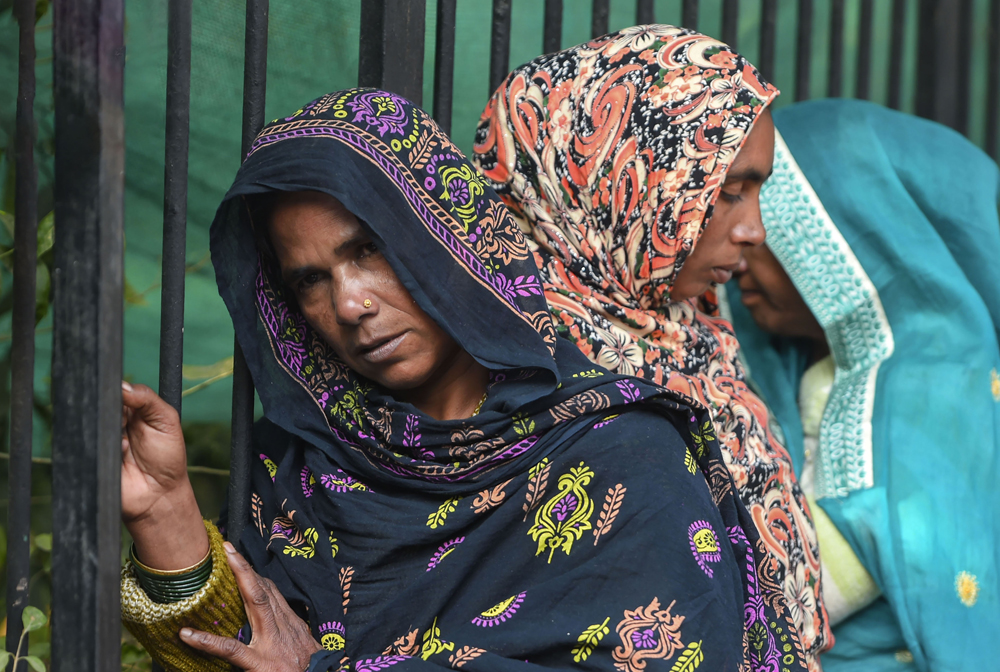Distraught relatives of a victim of the Anaj Mandi fire at Delhi's Maulana Azad Medical College on December 10