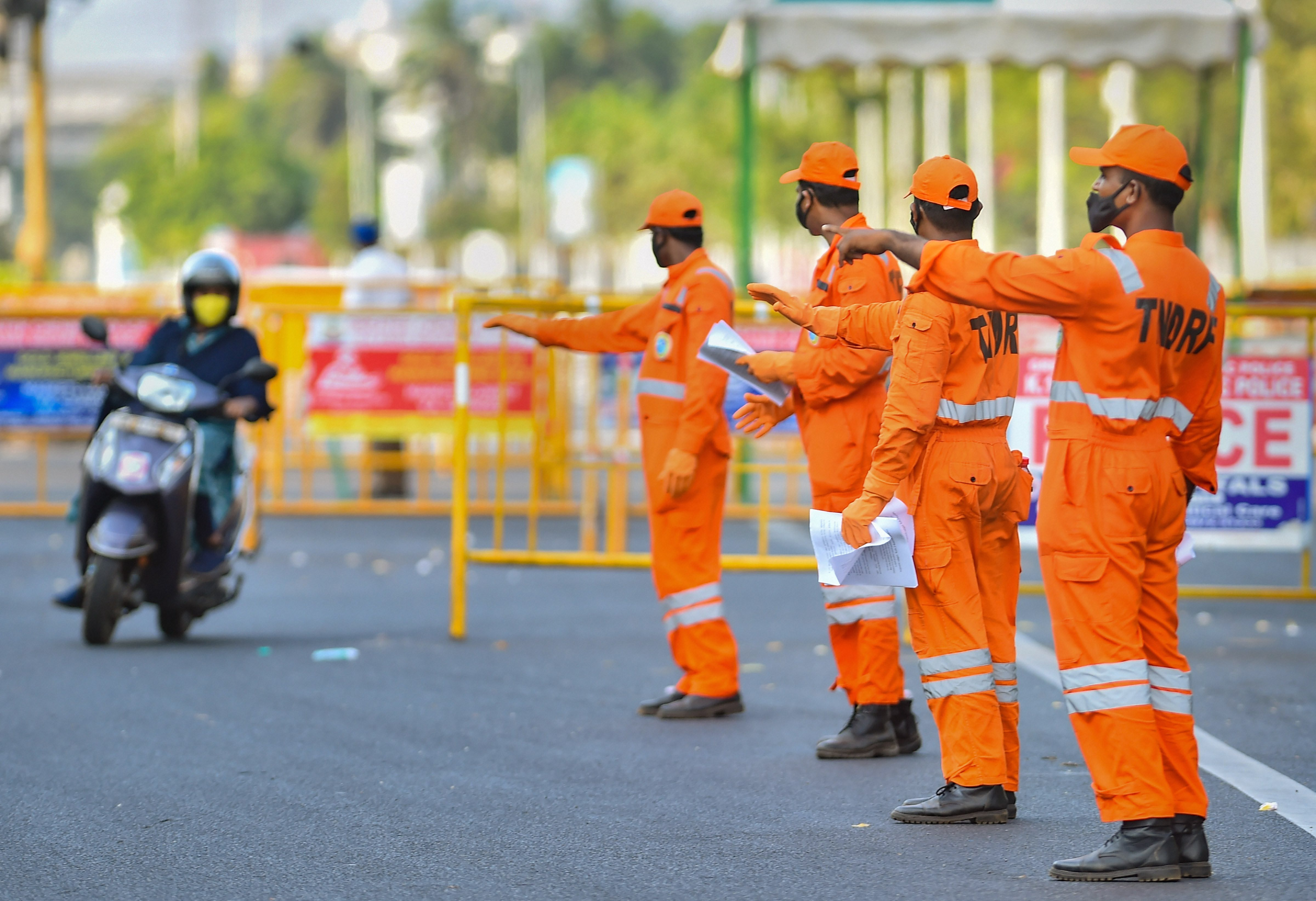 Tamil Nadu Disaster Response Force (TNDRF) personnel stop a bike rider to spread awareness on the importance of staying home in wake of the coronavirus pandemic, during the nationwide lockdown, in Chennai, Wednesday, April 8, 2020