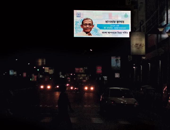 A picture of Nobel laureate Abhijit Vinayak Banerjee welcoming him to Bengal was being displayed in a LED display board on Saturday.
