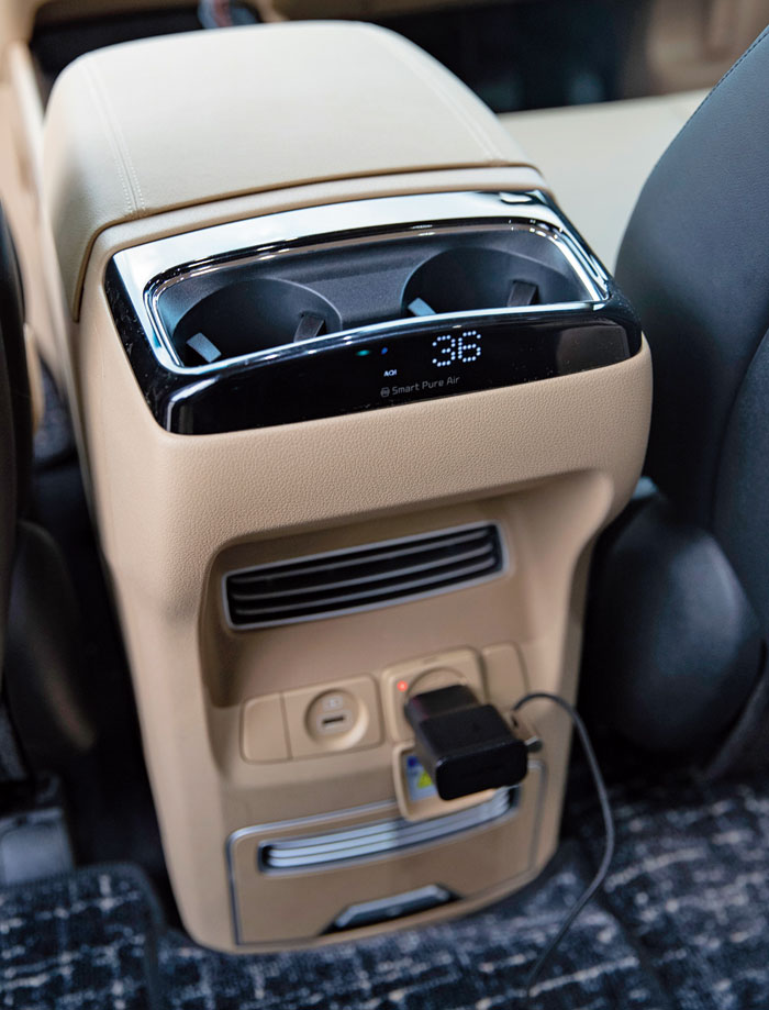 The vehicle has a hepa filter to clean the air and a readout tells you how clean it is. Below it is a 220V, two-pin socket for chargers.