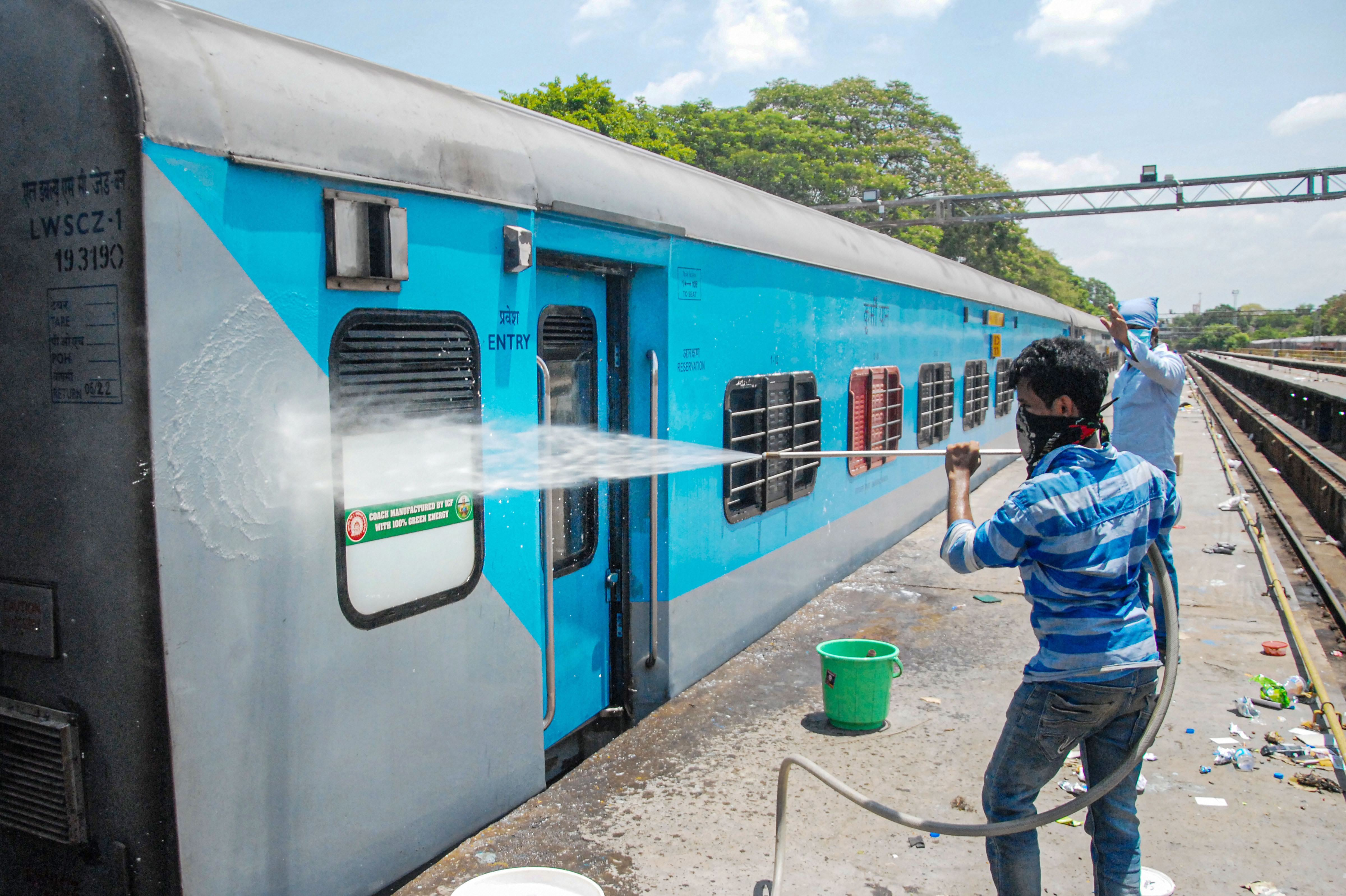 A worker sanitizes railway coaches following interstate train services will resume from June 01, during the ongoing Covid-19 lockdown, in Madurai, Sunday, May 31, 2020.