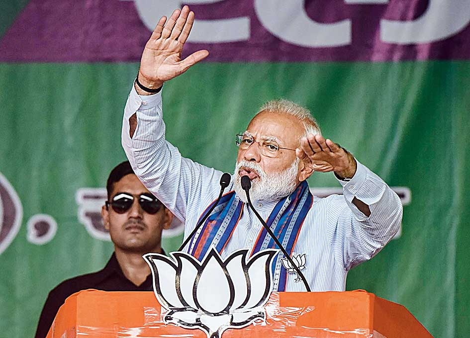 Modi addresses an election rally at Ramnagar in Bihar's West Champaran district on Saturday.