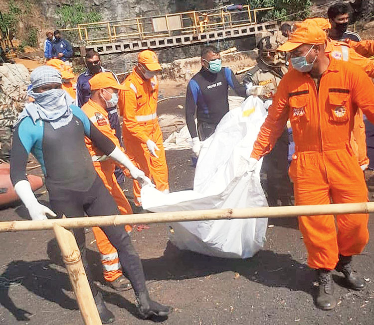 Rescuers carry a body bag on Wednesday