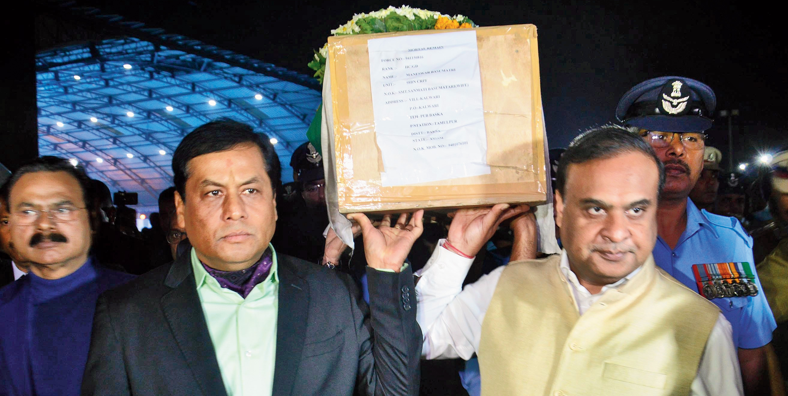 Assam chief minister Sarbananda Sonowal and finance minister Himanta Biswa Sarma help carry the coffin of Maneswar Basumatary at LGBI airport in Guwahati on Saturday.