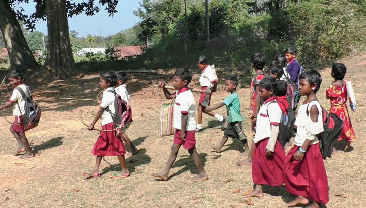 Children carry bows and arrows and axe in Galudih, Ghatshila, on Saturday.