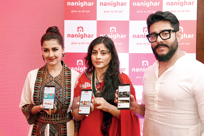 Brand ambassador Rachana Banerjee, founder Debjani Mukherjee and co-partner Raj Chakraborty display the mobile app. Nanighar is currently available on Android phones and has a website, and plans to launch on the iOS platform soon