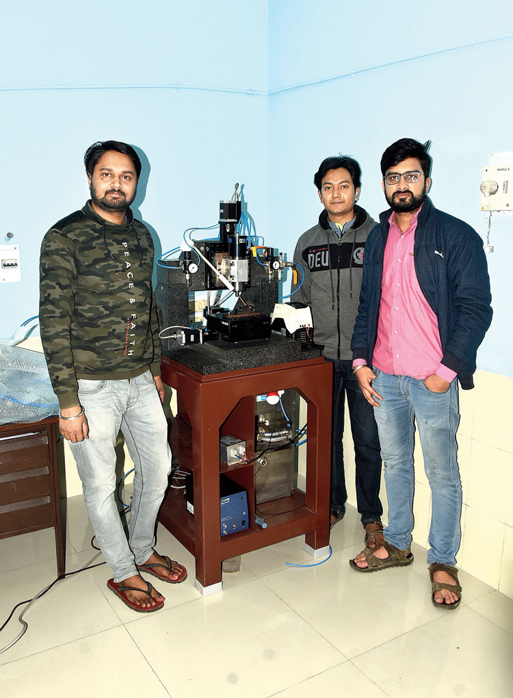 (From left) Shashank Shukla, Arnab Das and Ankit Jain with their micro tool device at the micro fabrication laboratory of IIT(ISM) in Dhanbad on Wednesday.