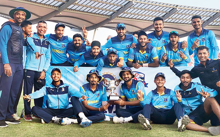 The triumphant Bengal U-23 players and support staff with the trophy, in Dehra Dun on Sunday