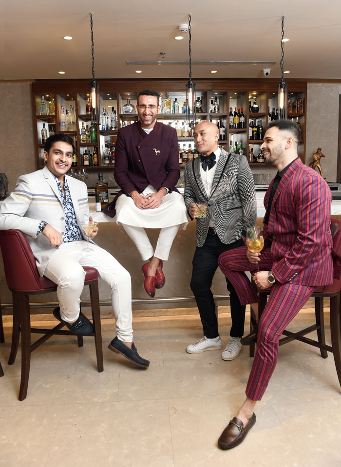"""(L-R) Aayush Killa, Sudhir Ahuja, Pravakar Yonzone and Vijyant Shah were in chill mode at Pa Pa Ya Calcutta, for the wrap-up shot! """"Ioved the casual look… sports coat,"""" said Aayush. Vijyant's pick was the striped suit and Pravakar's the digital-printed suit."""