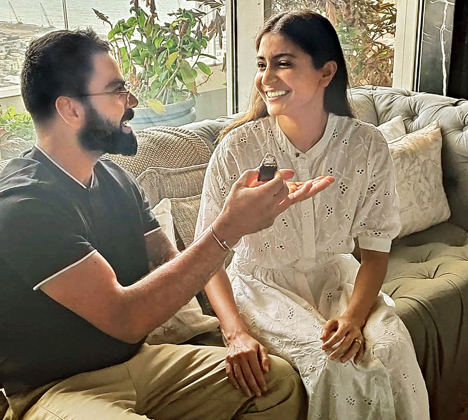 """India skipper Virat Kohli celebrates wife Anushka Sharma's birthday at home on Friday. Sharing a picture on Twitter and Instagram, offering his actress-wife a piece of birthday cake, Virat wrote: """"You my love bring light into this world. And you light up my world everyday. I love you."""""""