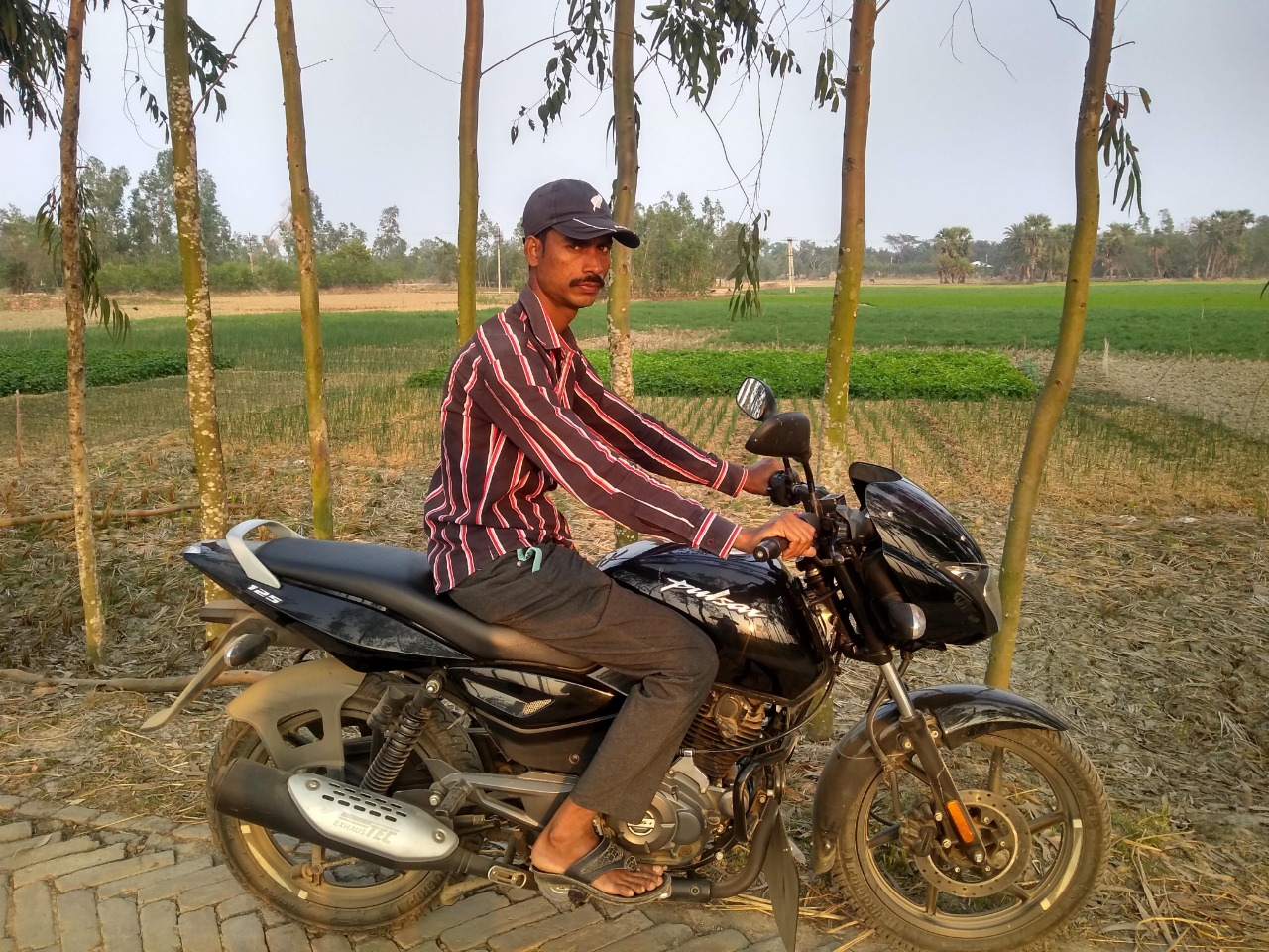 When I visited K-plot in February, Alauddin was waiting with his latest acquisition, a motorbike