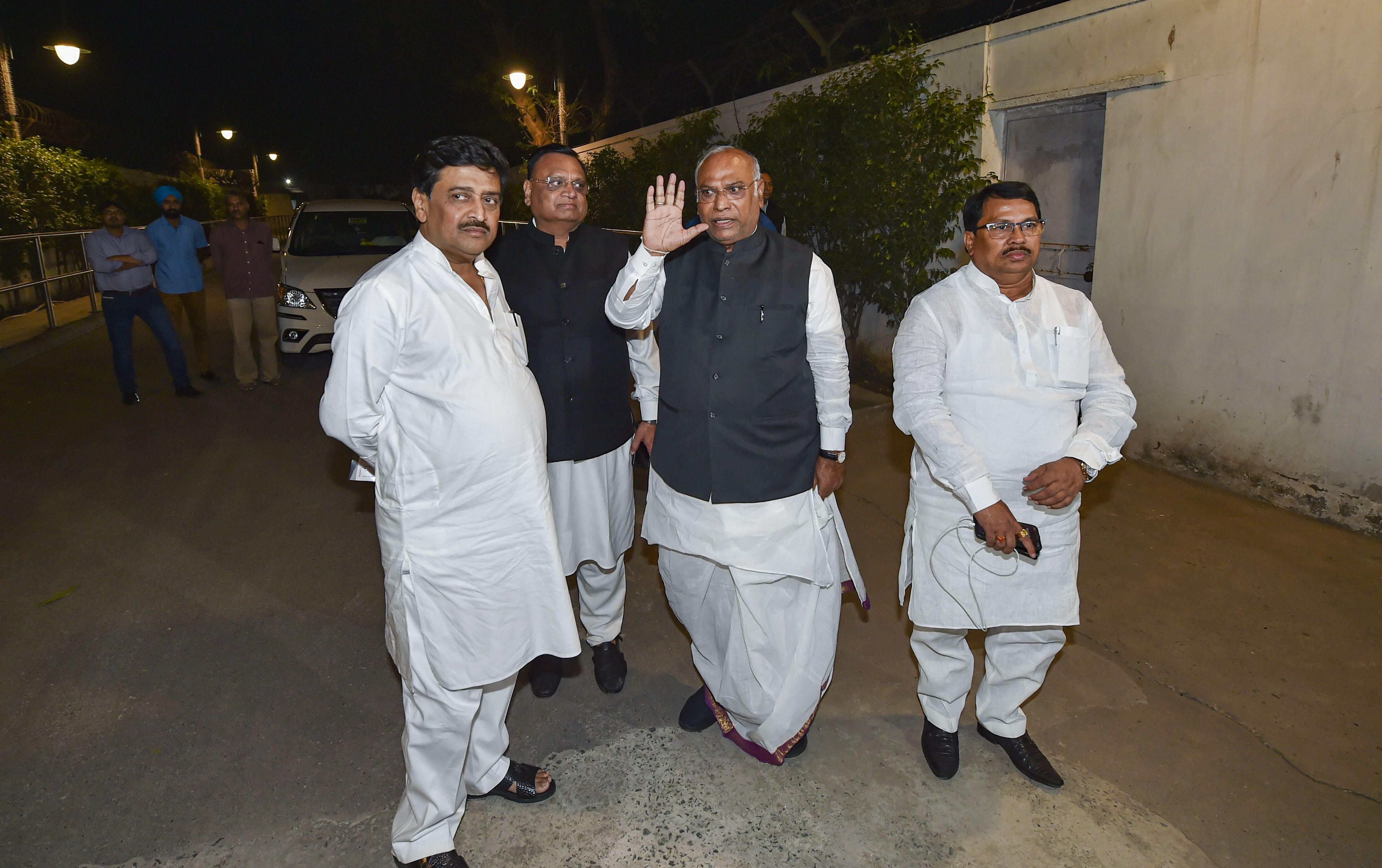 Senior Congress leader Mallikarjun Kharge with party leaders Ashok Chavan and Vijay Wadettiwar after a meeting with the party president Sonia Gandhi at 10 Janpath, in New Delhi, Monday, November 11, 2019.