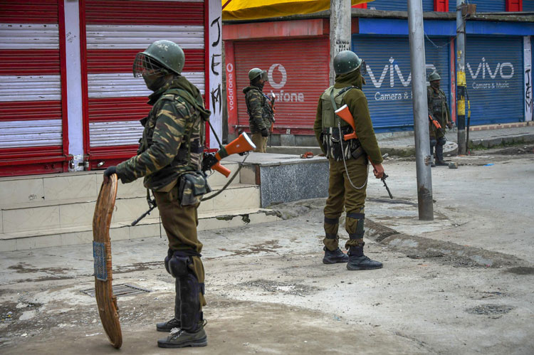 Security personnel stand guard in Srinagar on Friday
