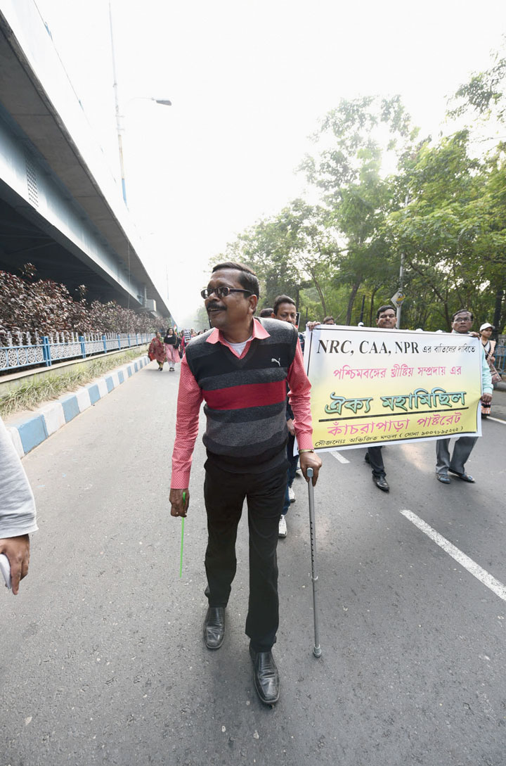 """Dibyendu Biswas, member of a Christian organisation at Kanchrapara in North  24-Parganas, around 51km from Calcutta, came with a stick. A bike accident in November has left him with a steel plate in his right leg and a limp. He walked the full course of the rally. """"My grandfather came from East Pakistan. He settled in Kanchrapara in 1948. After 72 years, my family members might be asked to prove our Indian-ness,"""" he said."""