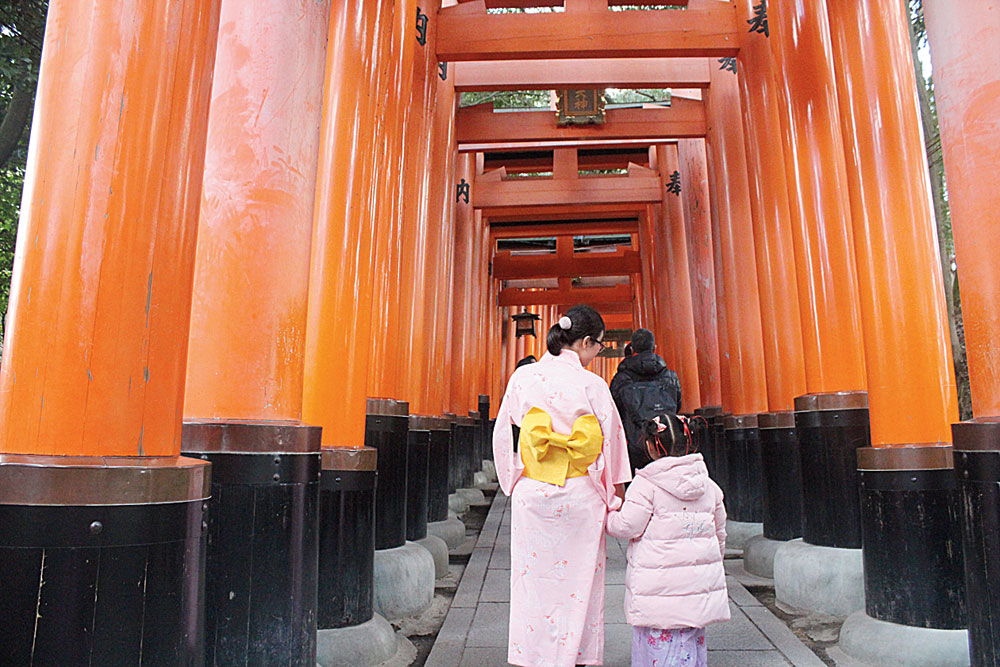 Thousand torii gates lead to the sacred Mount Inari