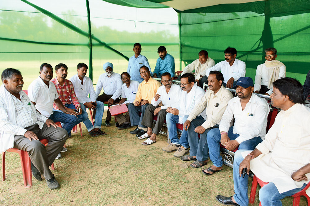 JMM workers at the party tent at Jamshedpur Co-operative College grounds in Bistupur on Tuesday.