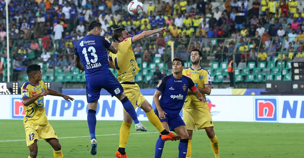 Chennaiyin FC and Kerala Blasters players tussle for the ball in the ISL match on Friday