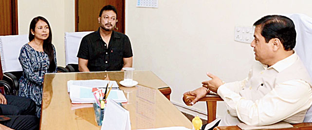 Chief minister Sarbananda Sonowal with filmmaker Rima Das on Friday.