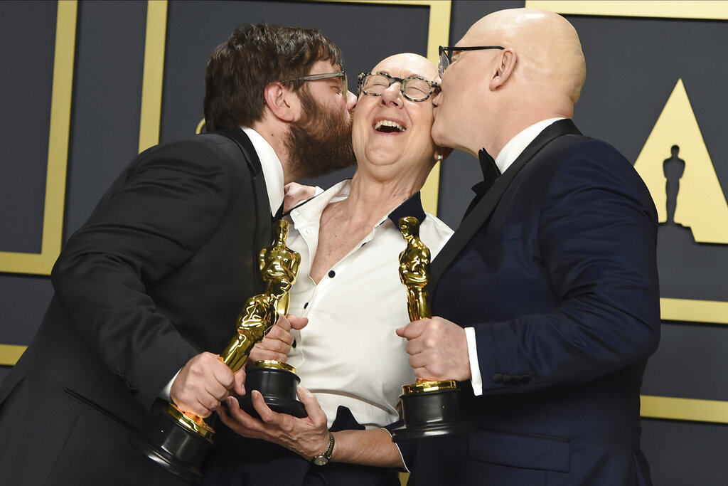 Jeff Reichert, from left, Julia Reichert, and Steven Bognar, winners of the award for best documentary feature for