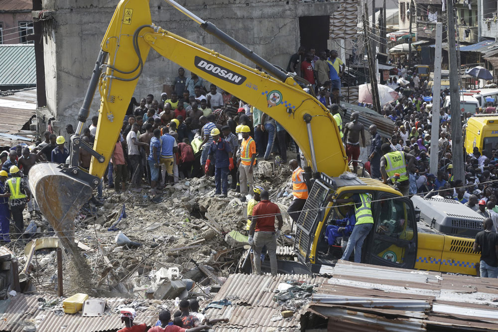 Emergency services attend the scene after a school building collapsed in Lagos, Nigeria on Wednesday, March 13, 2019