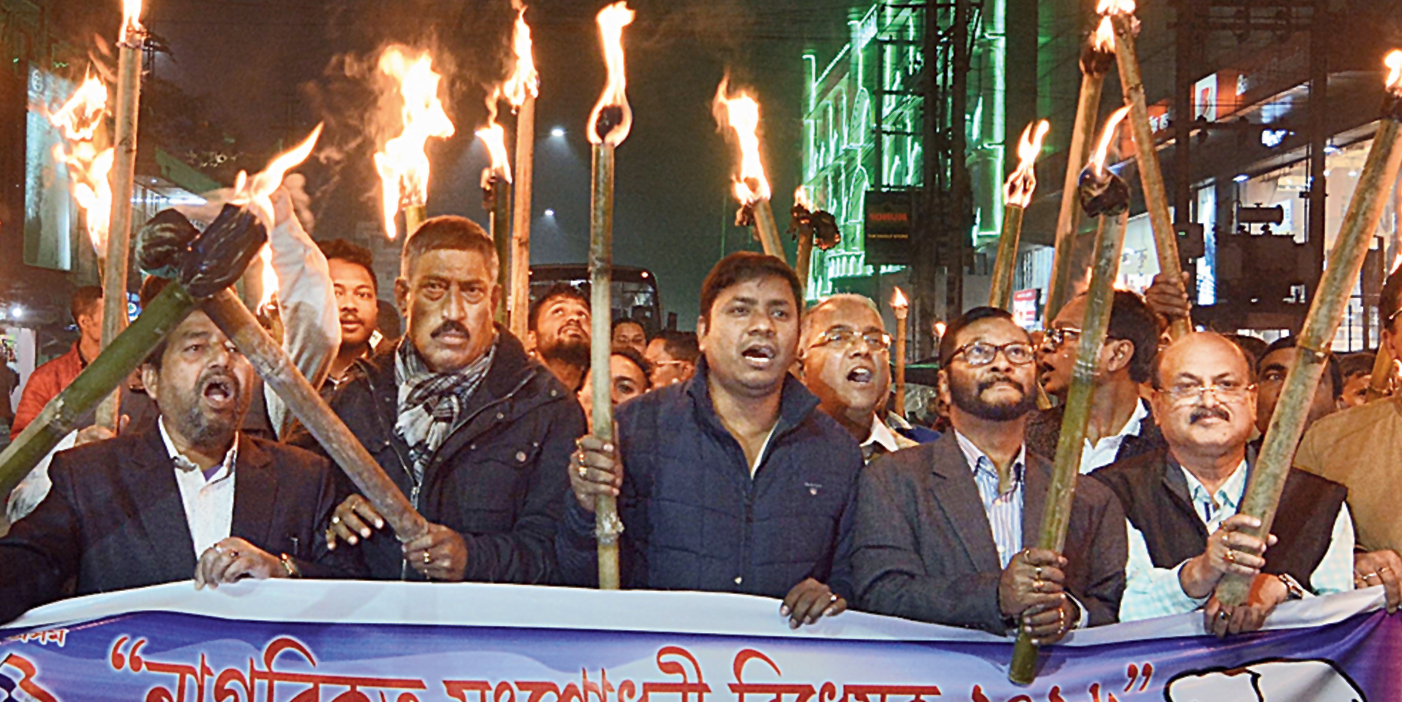 AGP activists take out a torchlight rally in protest against the Citizenship (Amendment) Bill, 2019, in Guwahati on Friday.