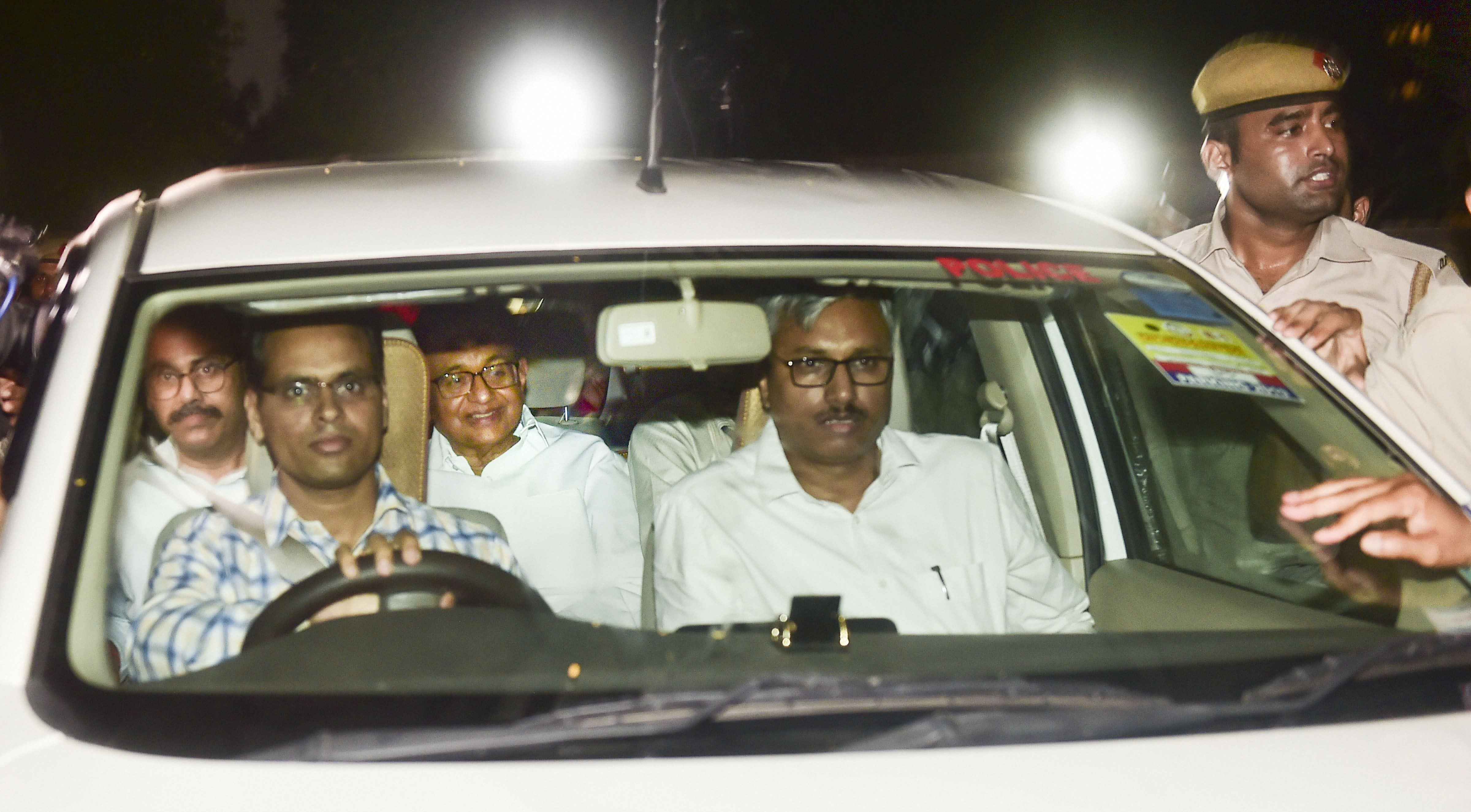 CBI officers take away Congress leader P. Chidambaram from his Jor Bagh residence in New Delhi on August 21.