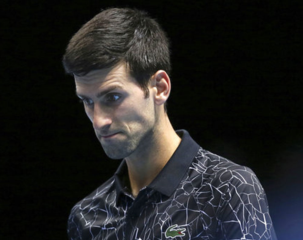 Novak Djokovic of Serbia during his ATP World Tour Finals tennis match against John Isner in London