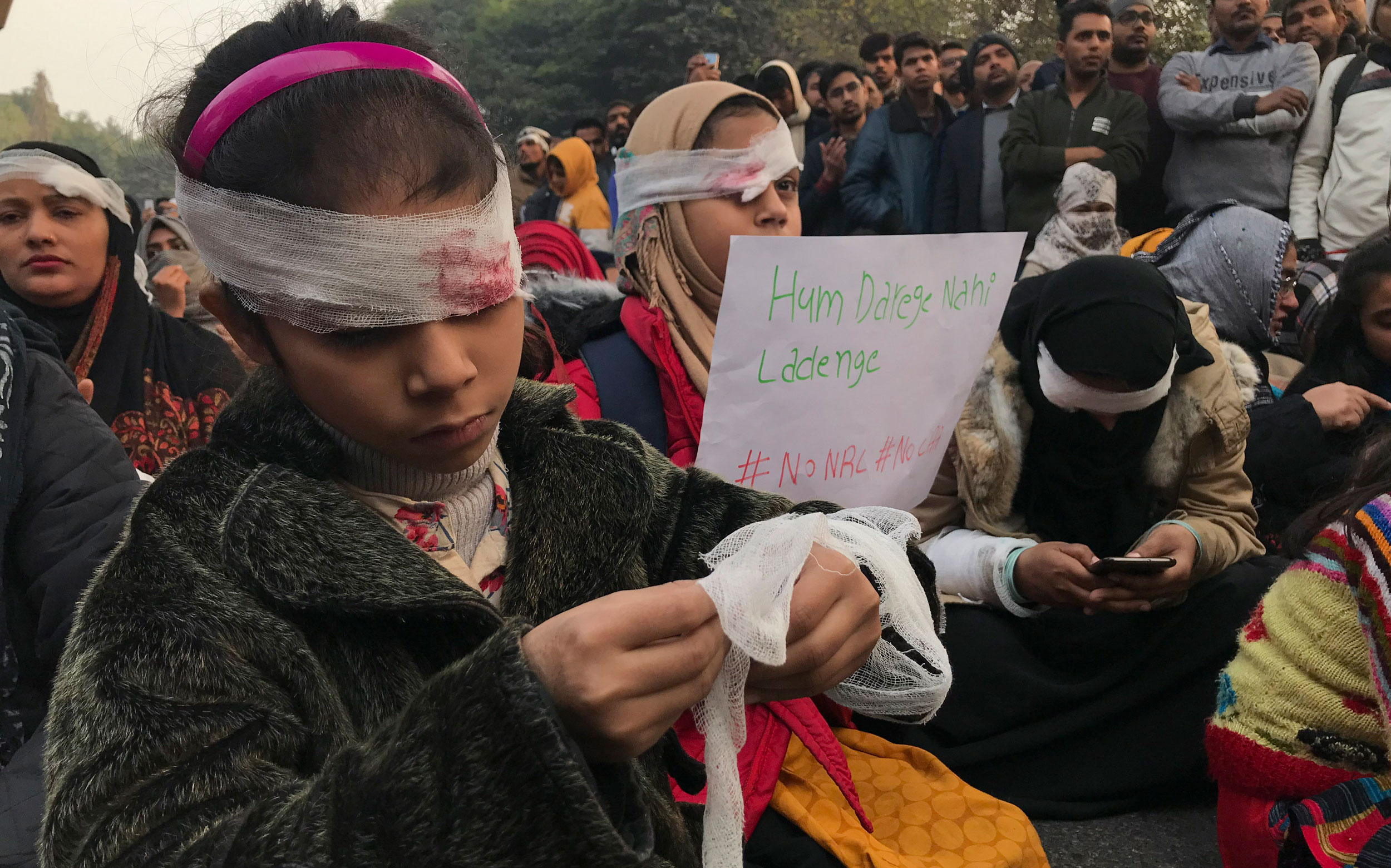 Protesters wearing bandages in solidarity with a student who lost his eye during the police attack on December 15 at Jamia University in New Delhi, on December 29, 2019.