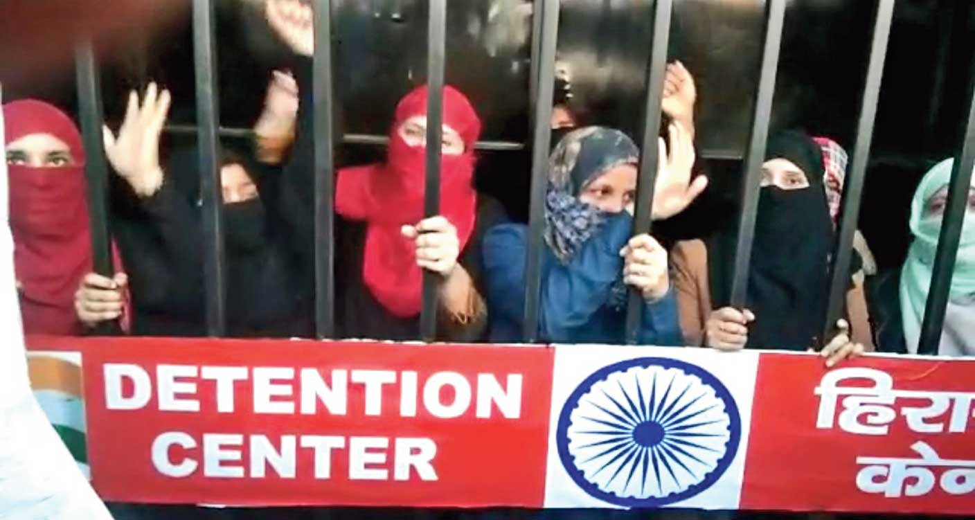 Women, inside the cage, protest against the newly amended citizenship law in Deoband, Uttar Pradesh