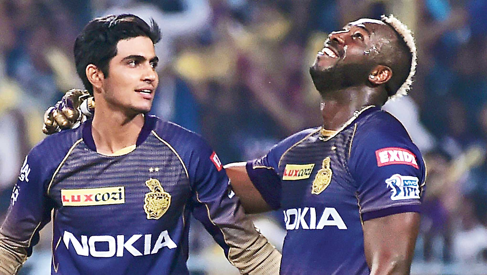 Shubman Gill and Andre Russell celebrate after the former hit the winning runs at the Eden on Sunday.