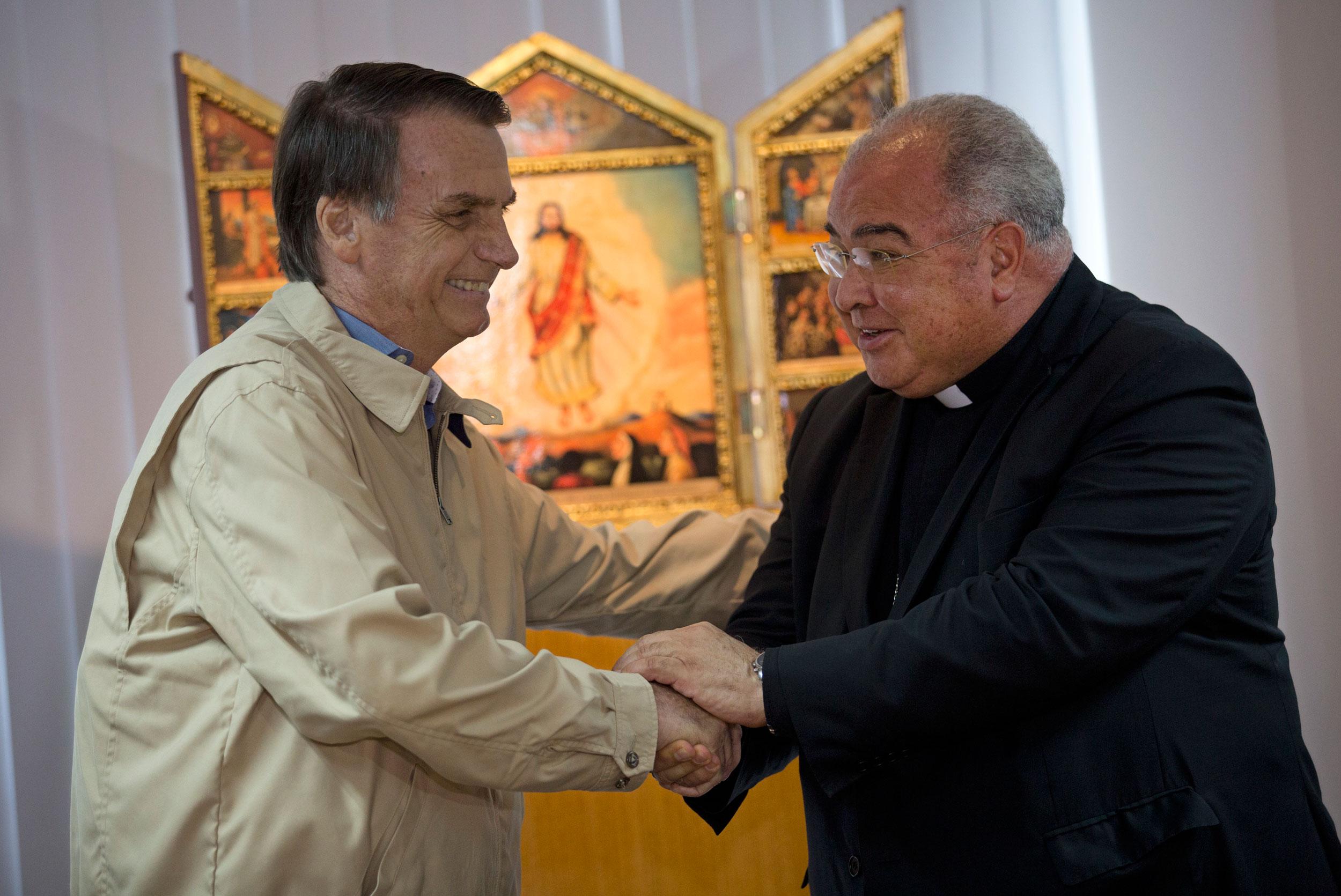 Presidential candidate Jair Bolsonaro (left) greets Rio de Janeiro's Archbishop Dom Orani Tempesta in Rio de Janeiro, Brazil, on Wednesday
