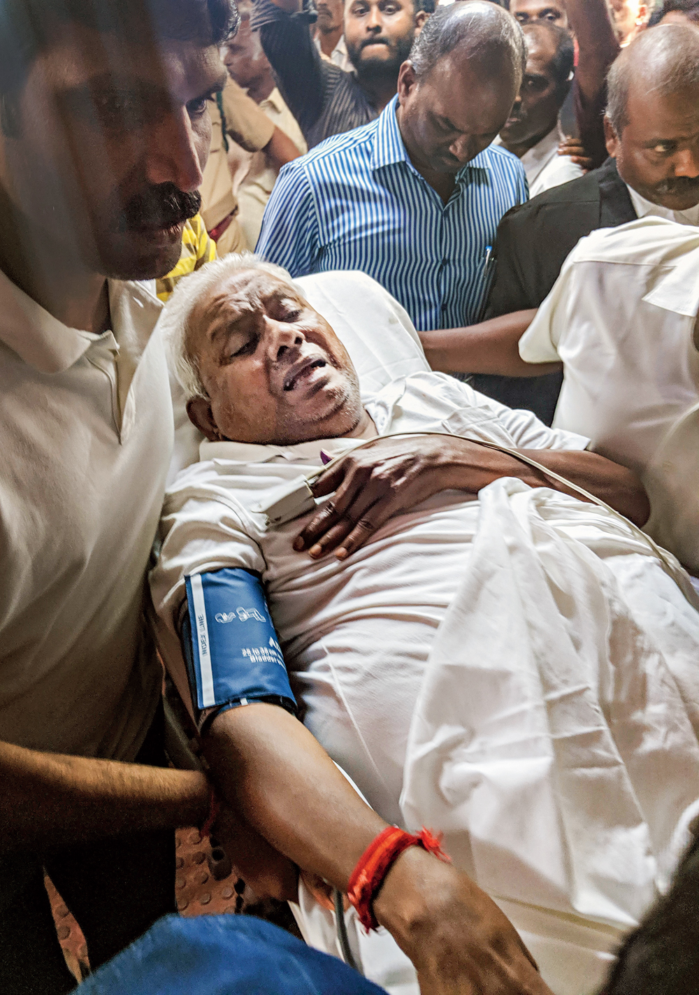 P Rajagopal, the founder of the Saravana Bhavan chain, arrives in a stretcher to surrender before a sessions court in Chennai on Tuesday