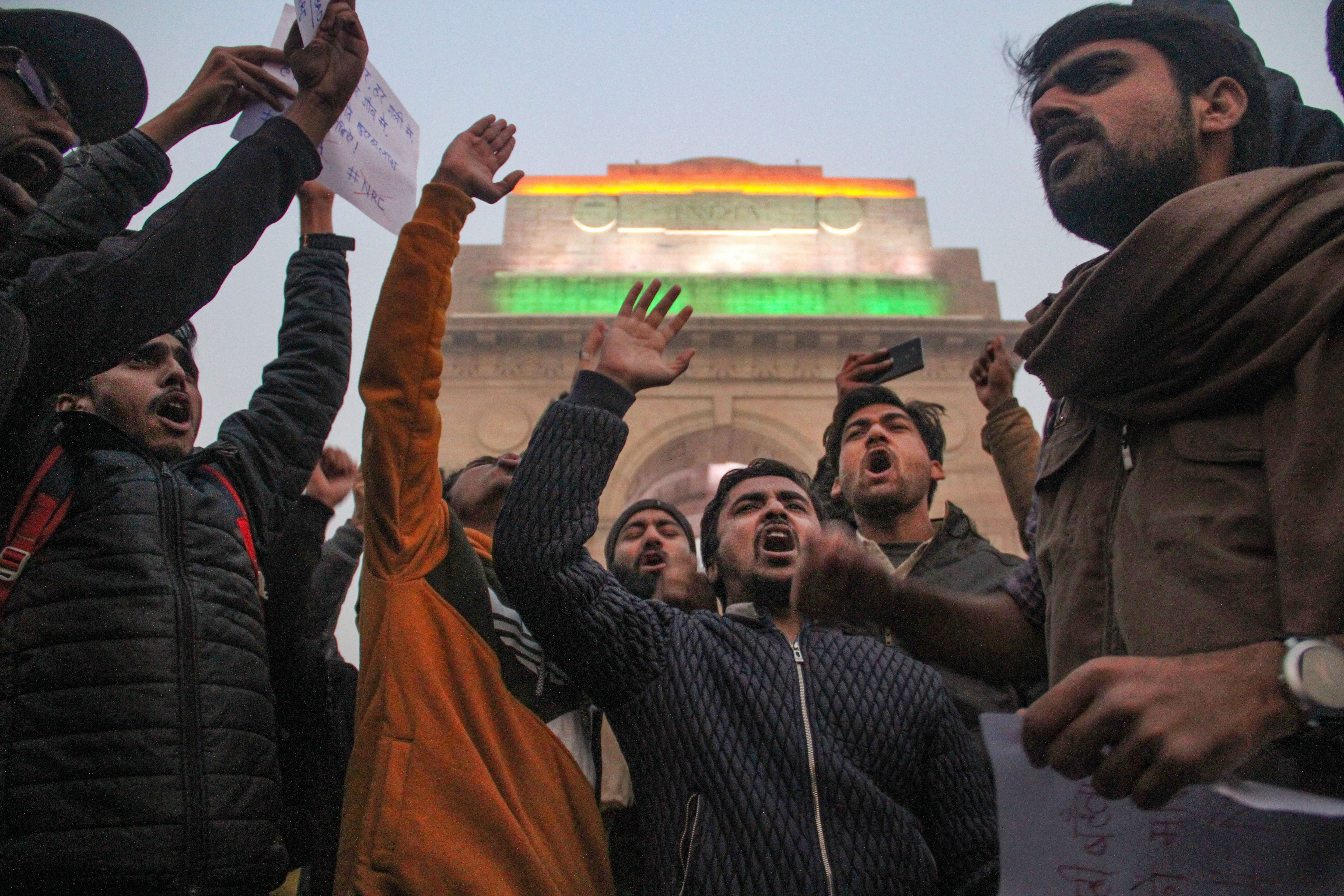 Protesters raise slogans during a demonstration against the Citizenship (Amendment) Act (CAA) in New Delhi, Friday, December 20, 2019.