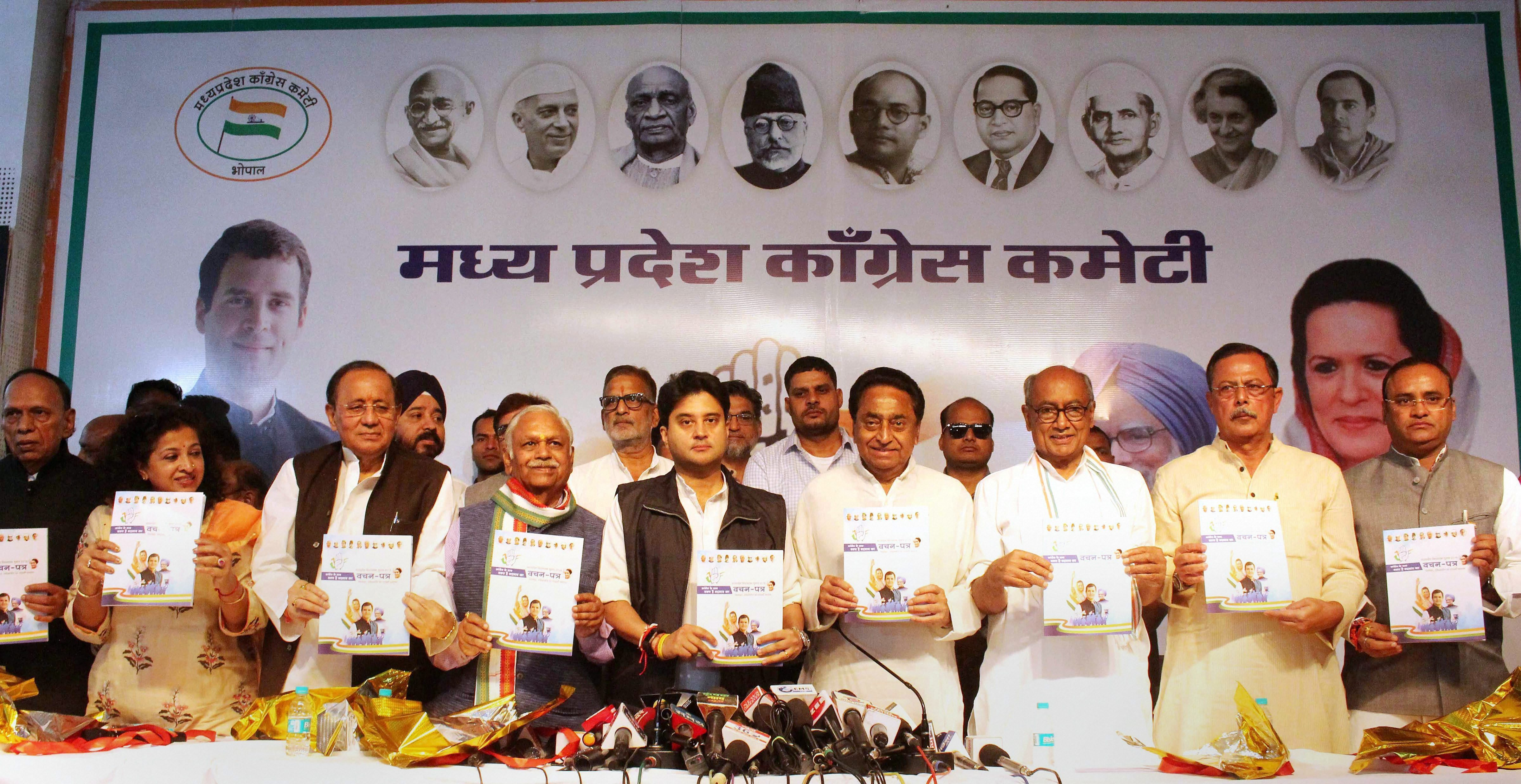 Congress leaders release the party manifesto in Bhopal on Saturday.