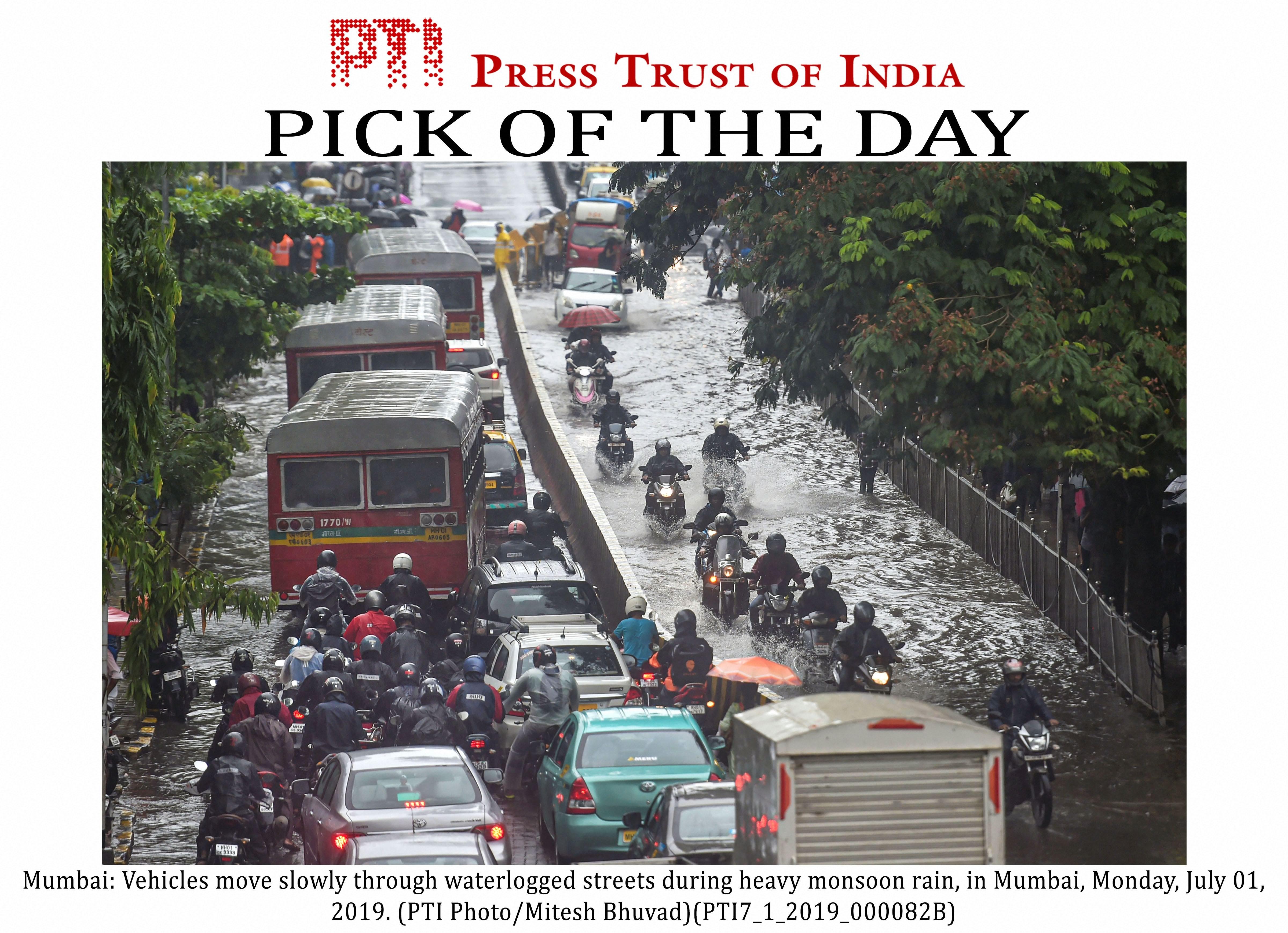 Vehicles stuck on waterlogged streets in Mumbai on July 1.