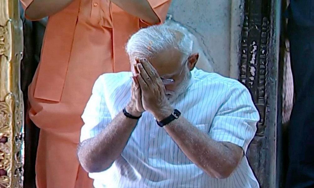 Narendra Modi offers prayers at Kashi Vishwanath Temple in Varanasi on Monday