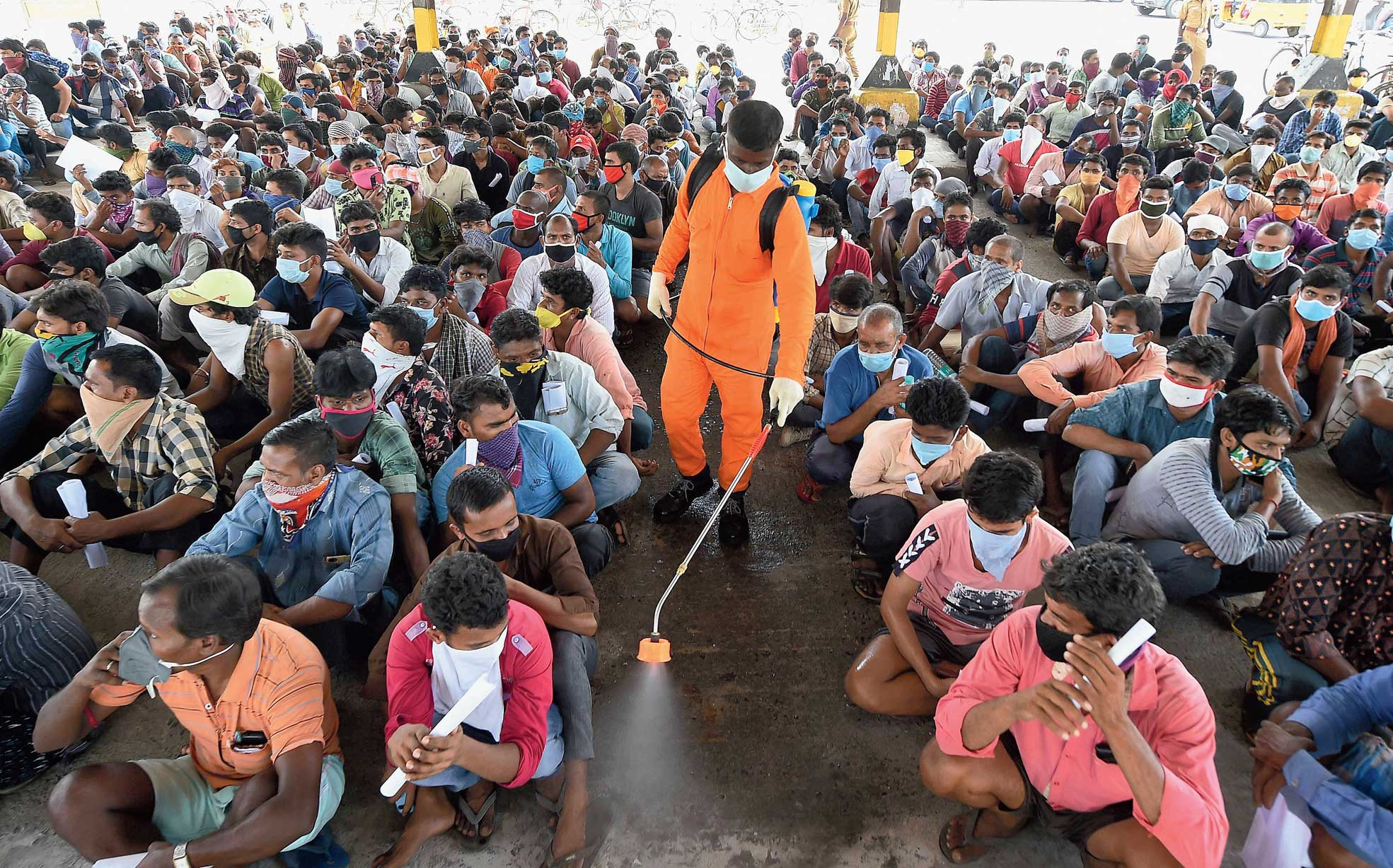 Migrants wait in Chennai for verification of documents to return home to Bihar.