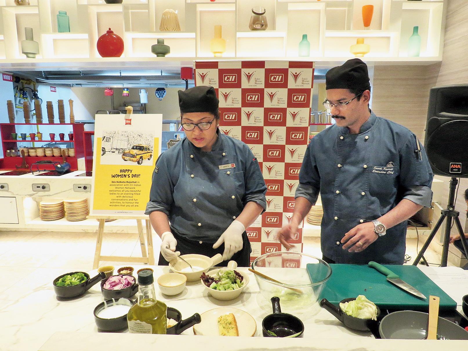 Chef Arpita Roy busy in the kitchen under the supervision of Sunil Kumar Gopalan, executive chef, Ibis Kolkata Rajarhat.