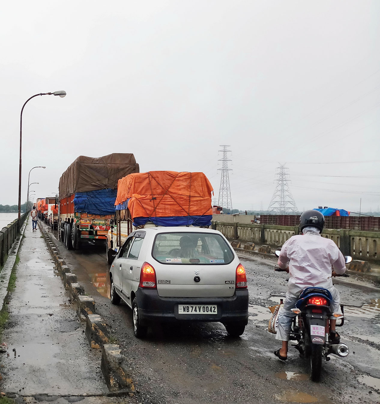 A traffic jam on the potholed Teesta bridge on Jalpaiguri outskirts on Saturday.