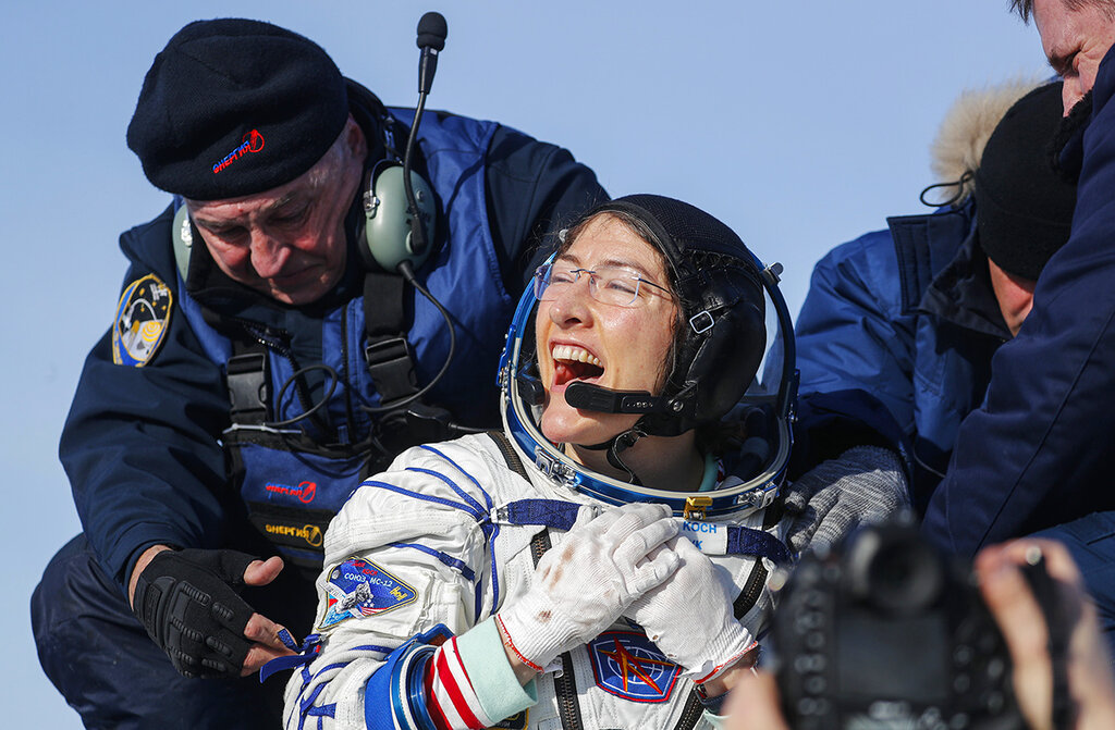 U.S. astronaut Christina Koch reacts shortly after the landing of the Russian Soyuz MS-13 space capsule about 150 km ( 80 miles) south-east of the Kazakh town of Zhezkazgan, Kazakhstan