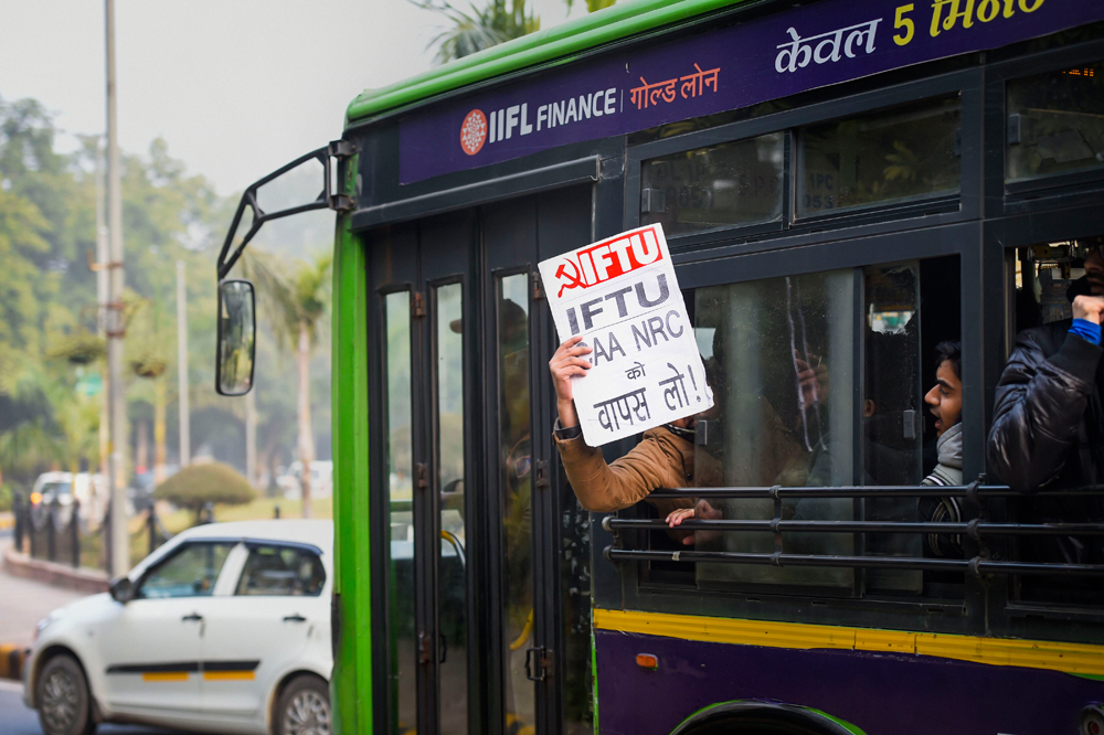 Protesters after being detained in New Delhi on Friday