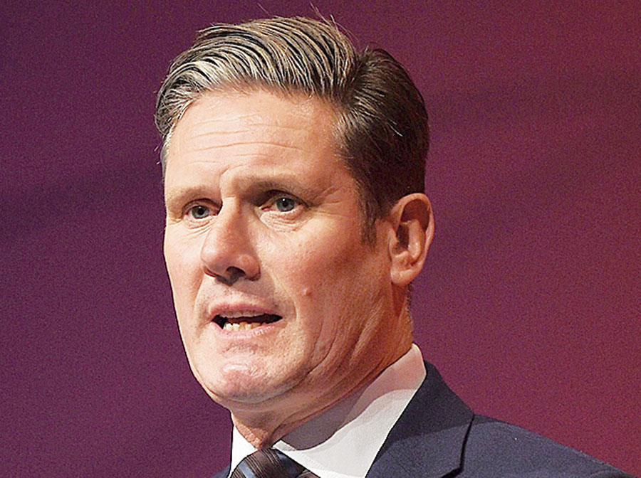 Labour Party's Brexit secretary Keir Starmer addresses delegates on the third day of the party conference in Liverpool on Tuesday